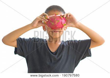 Asian boy shutting eyes with dragon fruit isolated on white background