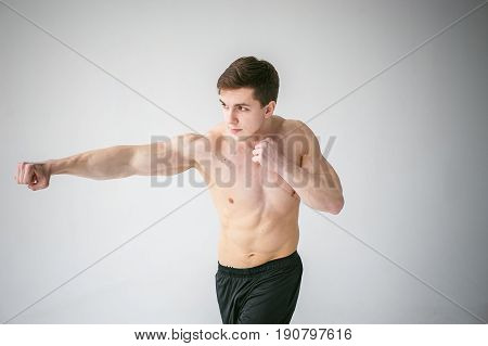 Young Sexy Handsome Men Of Strong Athlete's Body With Bare Torso, Dressed Black Sports Shorts, Portr