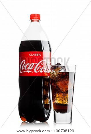 London, Uk - June 9, 2017: Bottle And Glass With Ice Cubes Of Coca Cola Soft Drink On White.the Coca