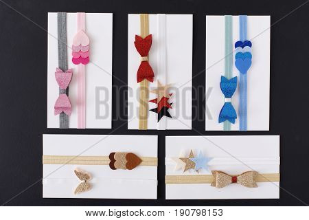 Collage with decorative headbands. Bright colorful handmade hair accessories with felt decoration. Beauty, fashion, style concept