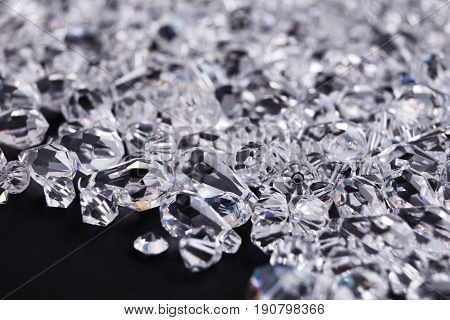 Beautiful diamonds on black background, close up. Pile of crystals close-up. Jewelry, luxury, treasure concept