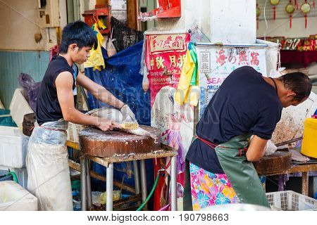 Fishmonger Cleans Fresh Fish