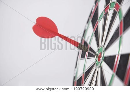 target red arrow on center of dartboard. concept business goal to marketing success.