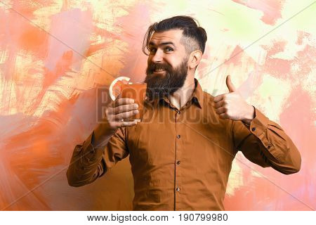 Brutal Caucasian Hipster Holding Tropical Alcoholic Fresh Cocktail