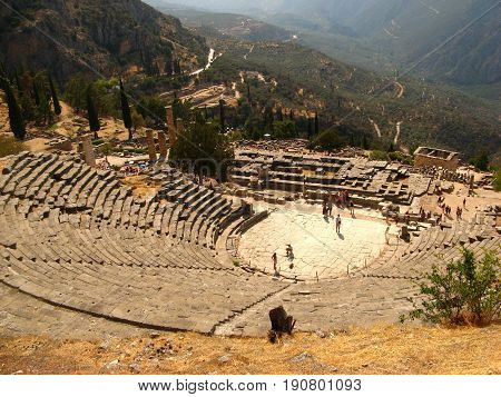View from the mountain to the ruins of an ancient amphitheater in Greek Delphi