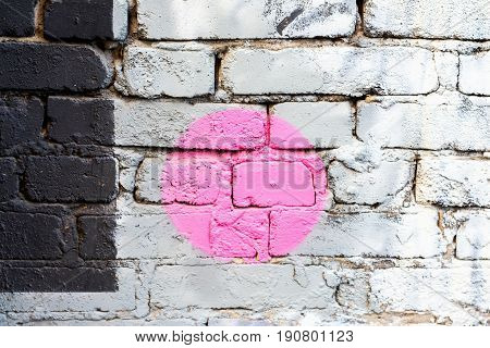 Abstract colorful brick wall with fragment of graffiti, drawings art close-up. Concept of Modern iconic urban culture. For background, pattern, wallpaper or banner design