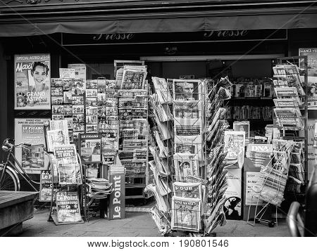 PARIS FRANCE - JUN 12 2017: French press kiosk with International and French newspapers with reactions to French legislative election 2017 a day after first round
