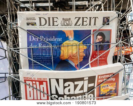 PARIS FRANCE - JUN 12 2017: Man point of view personal perspective buying at press kiosk German newspaper with Trump and Nazi message on the Bild magazine