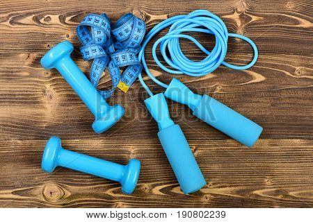 Sport Exercise Concept With Measuring Tape, Skipping Rope And Dumbbells