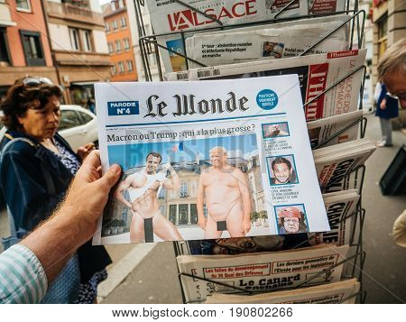 PARIS FRANCE - JUN 12 2017: Man point of view personal perspective buying at press kiosk French newspaperLe Wonde with reactions to French legislative election 2017 a day after first round
