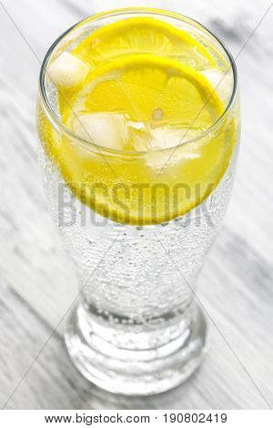 Cold mineral water with ice and lemon.Mineral water closeup