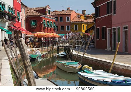 BURANO, ITALY - MAY 23, 2017: Bridge with tourist in the center of Burano