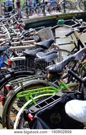 tangle of bikes in bicycle rack in Amsterdam