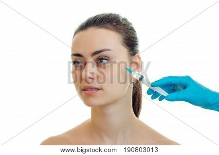 the face of a young pretty girl without makeup which doctor does prick isolated on a white background close-up