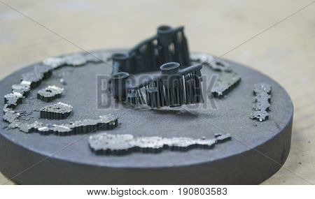 Object denture body printed on a laser sintering machine on the work disk