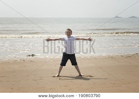 Ten year old boy playing on the beach