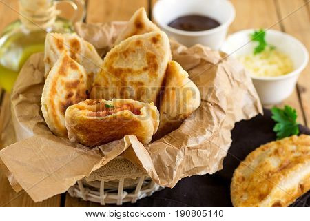 Fried flatbreads filled with ketchup cheese and sausages