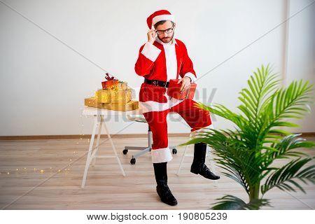 A portrait of a Santa Claus working