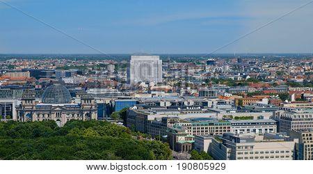 Berlin skyline over the Reichstag building Brandenburger Tor ( Brandenburg Gate) Berlin Germany.