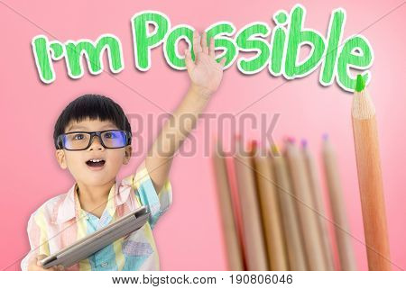 Boy raise his hand confidence that he is possible to do everything