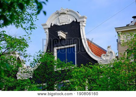 a detail of the gable end of a dutch canal side house in Amsterdam