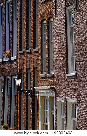 brickwork and windows of houses in amsterdam
