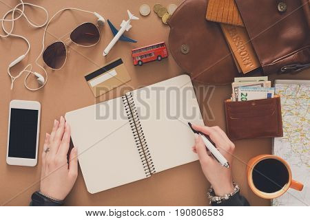 Travel planning concept top view. Vacation plan on rustic wooden background, search for best trip, copy space for text