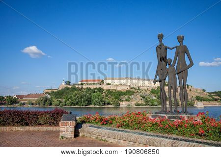 NOVI SAD SERBIA - JUNE 11 2017: Monument dedicated to the victims of the Shoah in Serbia in front of the Petrovaradin Fortress one of the main landmarks of Novi Sad