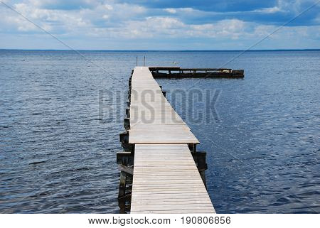 Traditional wooden bathing pier by the coast of the swedish island Oland in the Baltic Sea