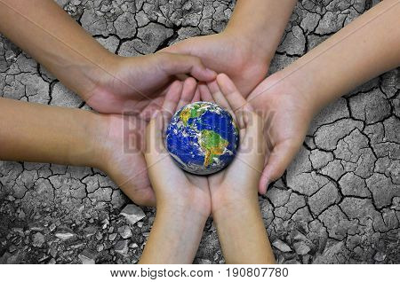 Earth Planet In Asian Children Hand Isolated On Ground Arid Barren