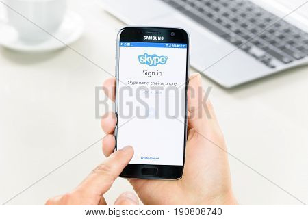 Krynica Poland - June 10 2017: Samsung Galaxy S7 in the hand when sign in Skype applications. Skype is one of the most popular communication service in the world.