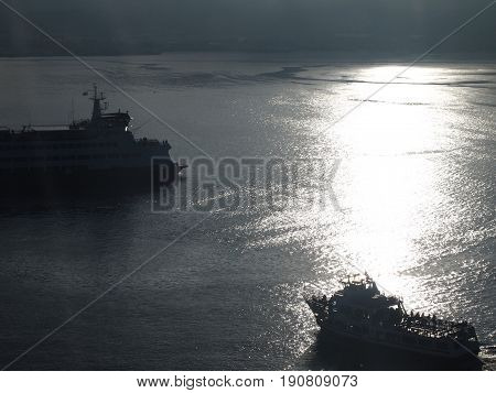 Ferries backlit in Elliot Bay, Seattle, Puget Sound, Washington.