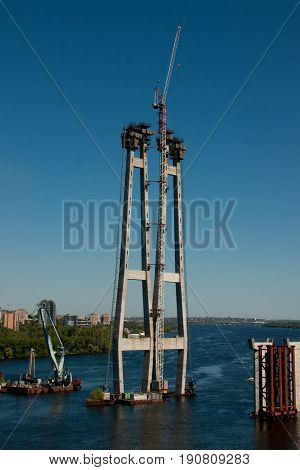 High support in the Dnieper River for a new bridge with a crane at the top