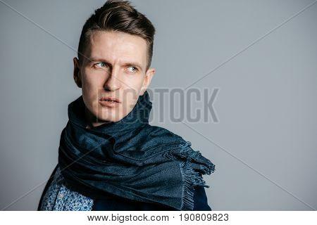 Portrait of fashionable stylish man, studio shot