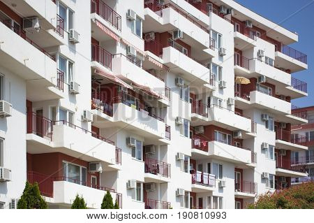 facade of a new modern apartment house with white balconies