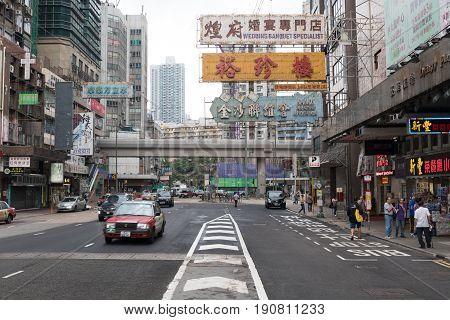 KOWLOON HONG KONG - APRIL 21 2017: Tipical Street at Working Day Morning in Kowloon Hong Kong.