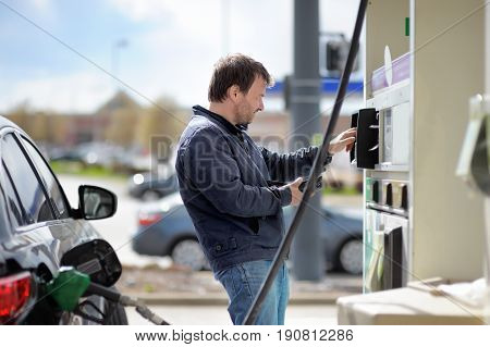 Man Filling Gasoline Fuel