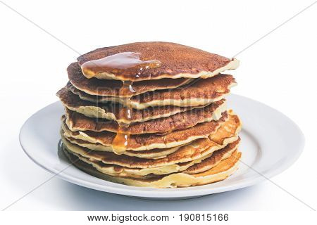 Pancakes with maple syrup isolated on a white background. Breakfast snacks. Pancakes Day.