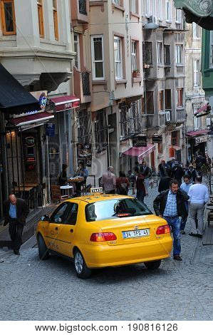 ISTANBUL TURKEY - APRIL 30 2012: Taxi in crowded narrow lane in Istanbul