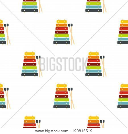 Colorful xylophone toy and sticks pattern seamless background in flat style repeat vector illustration