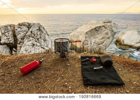 Tourist equipment and tools: camping gas over sea background