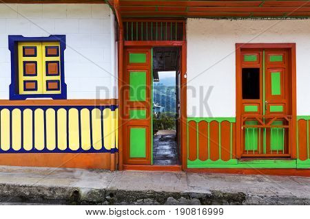 Detail of the door and windows of a house painted in bright colors in the town of Salento in Colombia South America