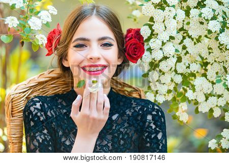 Woman Smiling With White Flower In Mouth