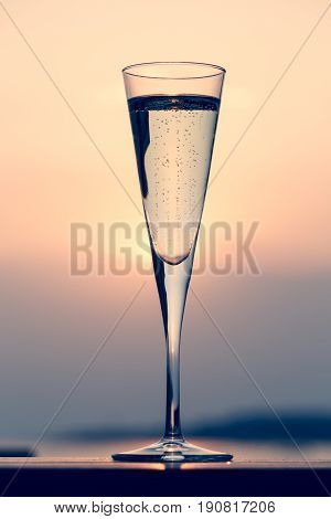 Glass Of Prosecco At A Wooden Pier At Sunset. Luxury Resort Vacation Concept. Festive Relax Getaway