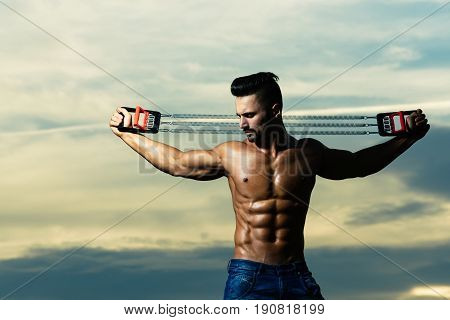 Workout Of Man With Muscular Body Workout With Expander Gripper