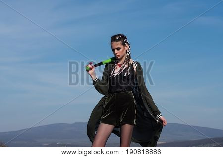 Woman In Black Sportswear Posing With Baseball Bat