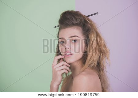 Pretty Woman With Metallic Nail In Wavy Hairstyle Thinking