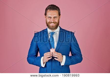 man or happy bride groom with gift box for jewelry in blue jacket and tie on pink background marriage and engagement valentines day holiday and celebration proposal and birthday wedding