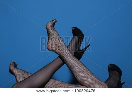Legs Of Sexy Women In Fashionable Tights And Shoes