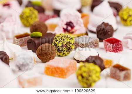 Selective focus on pistachio truffle candy among assortment of homemade confectionery poster